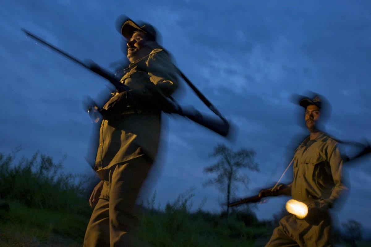 Guards on patrol at dusk in Kaziranga. (Photo: Steve Winter/National Geographic Creative)