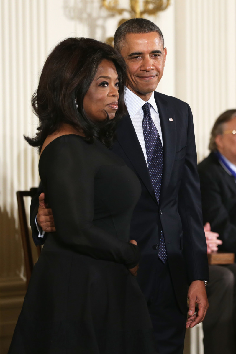President Barack Obama and Oprah Winfrey on stage before Winfrey receives the Presidential Medal of Freedom in the East Room at the White House on November 20th, 2013, in Washington, D.C.