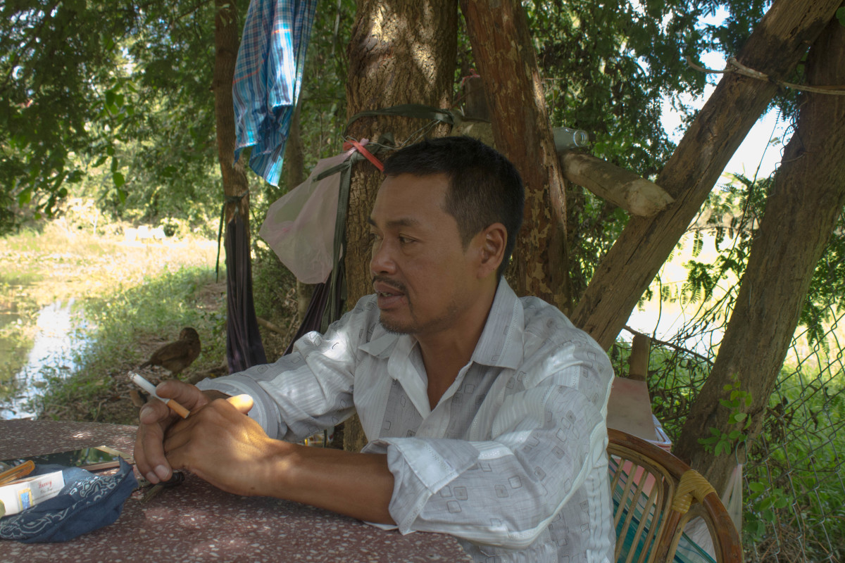 Nheb Thai in his yard.