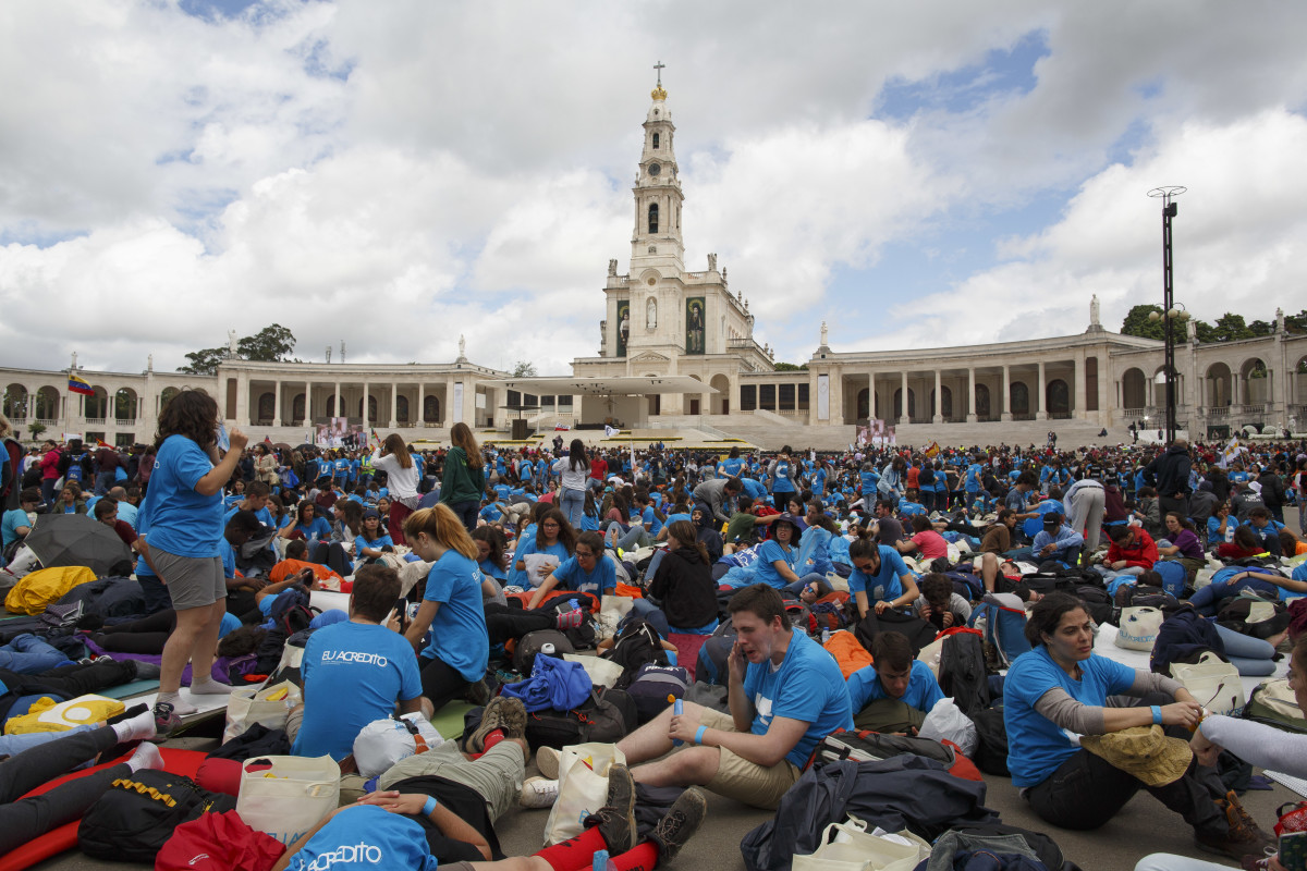 Young pilgrims wait for the arrival of Pope Francis at the Sanctuary of Fatima on May 12th, 2017, in Fatima, Portugal.