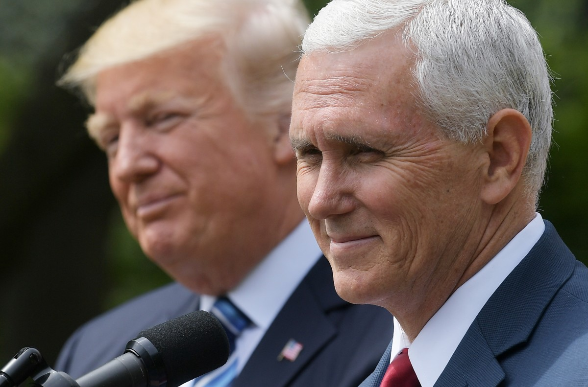 Vice President Mike Pence speaks while standing next to President Donald Trump during a ceremony before the signing of an executive order on promoting free speech and religious liberty in the Rose Garden of the White House on May 4th, 2017.