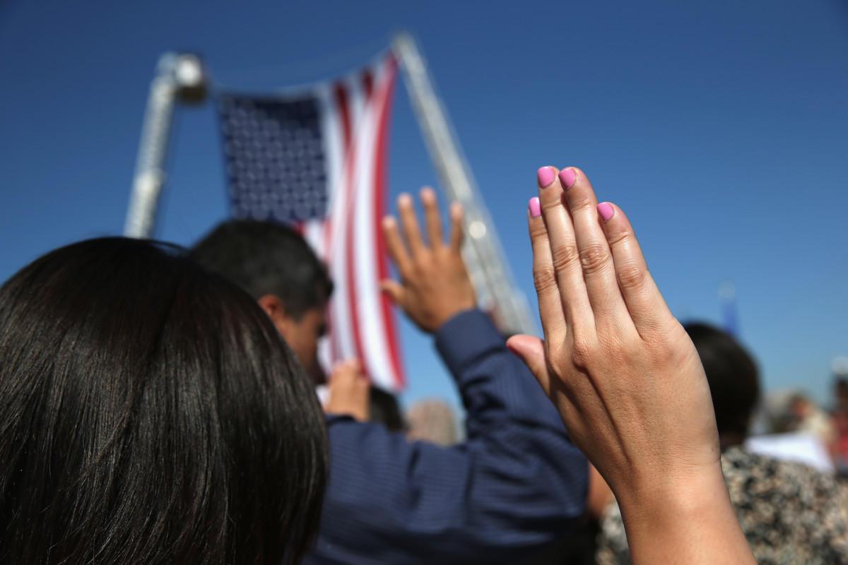 One hundred immigrants become American citizens during a naturalization ceremony at Liberty State Park in Jersey City, New Jersey.