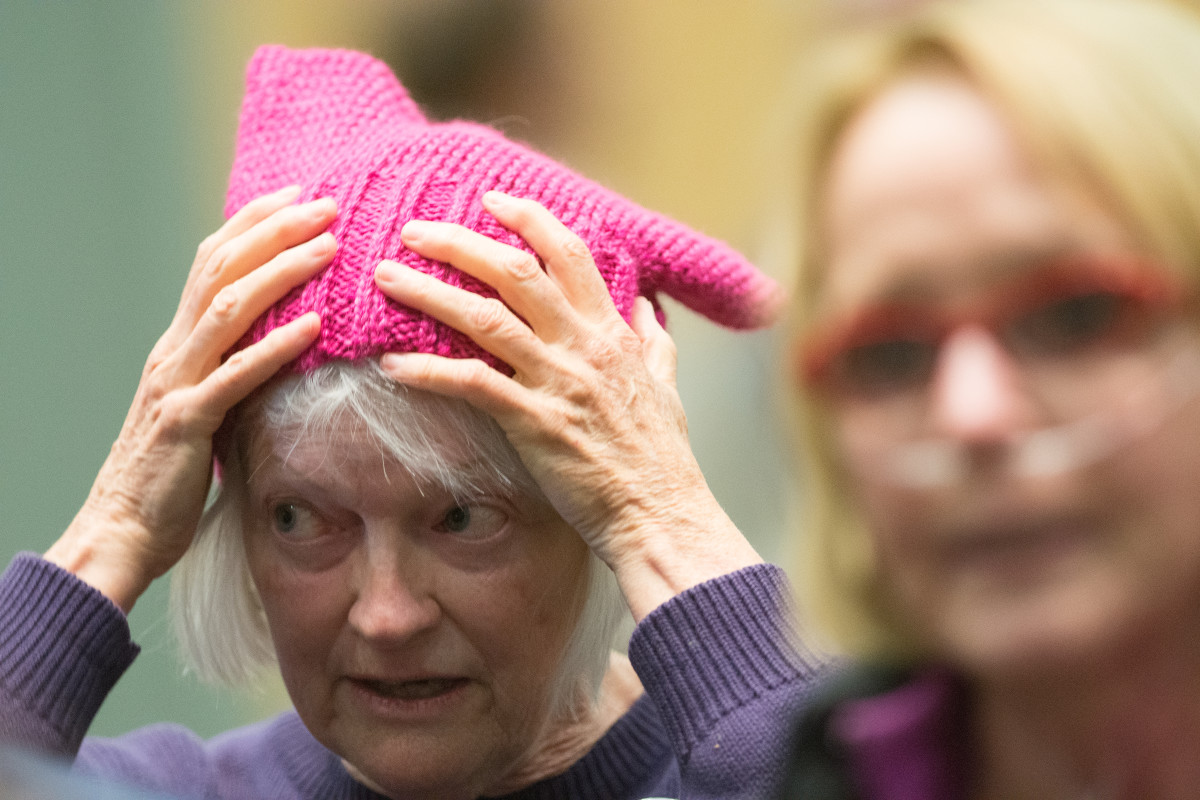Barb Lentz adjusts her pink hat during a town hall meeting featuring Representative Mark Amodei (R-Nevada) on April 17th, 2017.