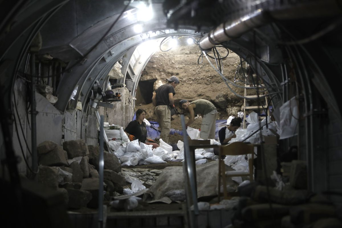 Israel Antiquities Authority and Nature and Parks Authority workers dig in an underground tunnel on May 25th, 2017, unveiling evidence from 2,000 years ago of the battle of Jerusalem following the destruction of the Second Temple.
