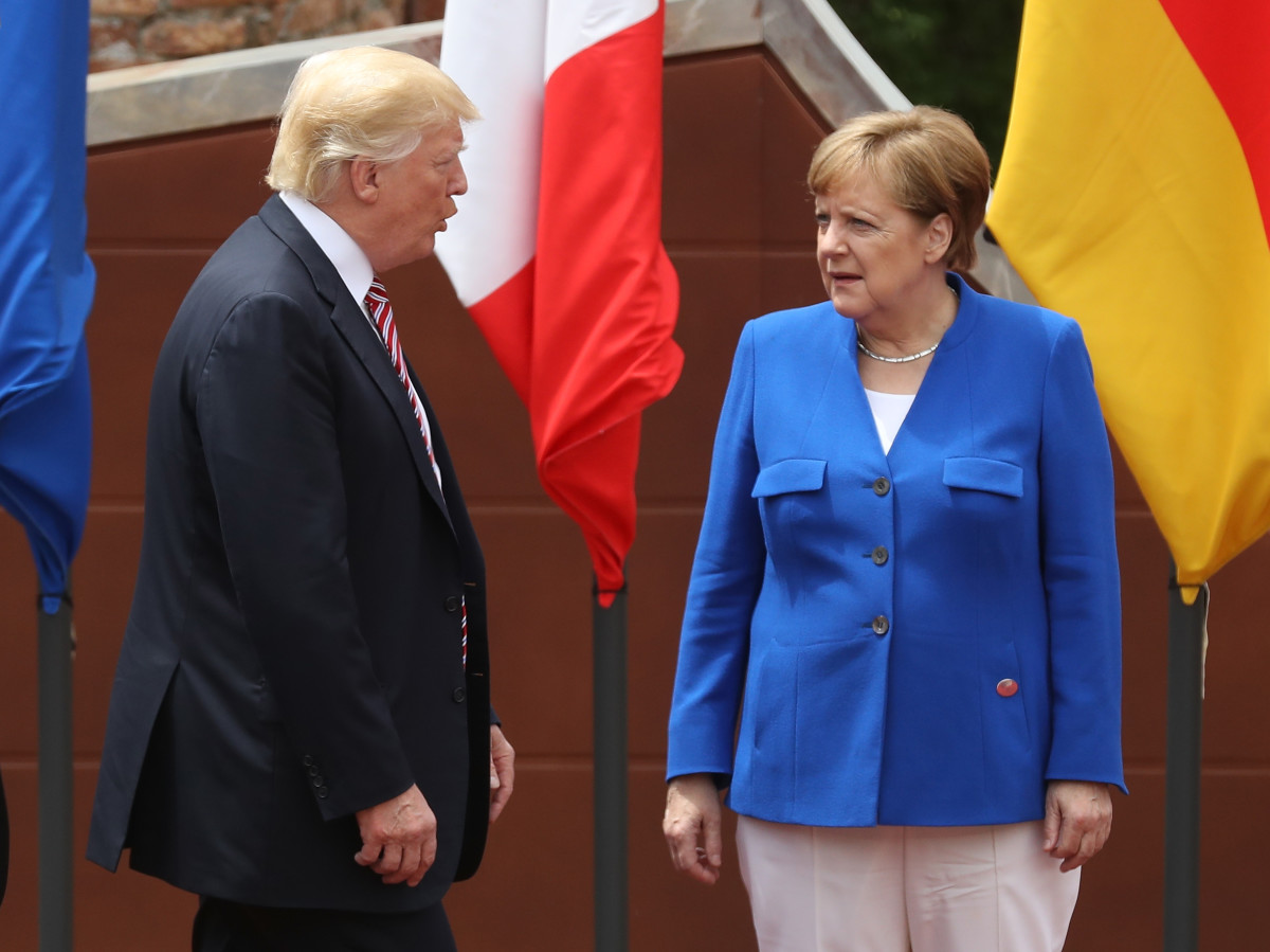 German Chancellor Angela Merkel and President Donald Trump arrive for the group photo at the G7 Taormina summit on the island of Sicily on May 26th, 2017.