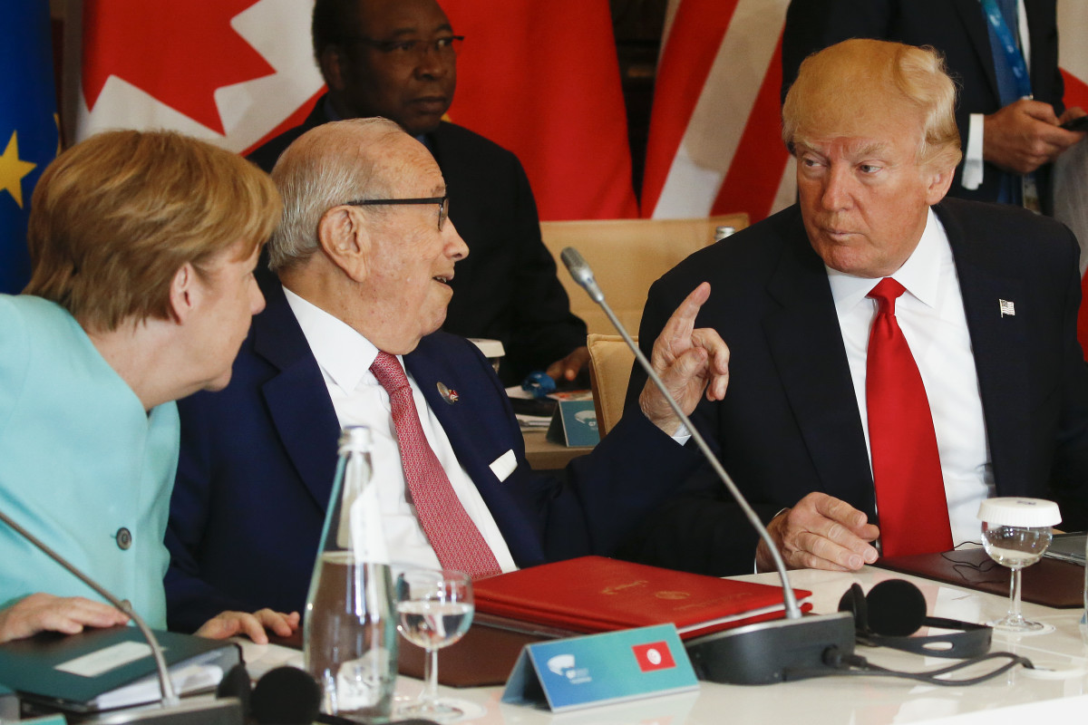 German Chancellor Angela Merkel with Tunisian President Beji Caid Essebsi and President Donald Trump at an expanded session during the Summit of the Heads of State and of Government of the G7, plus the European Union, in Taormina, Sicily, on May 27th, 2017.