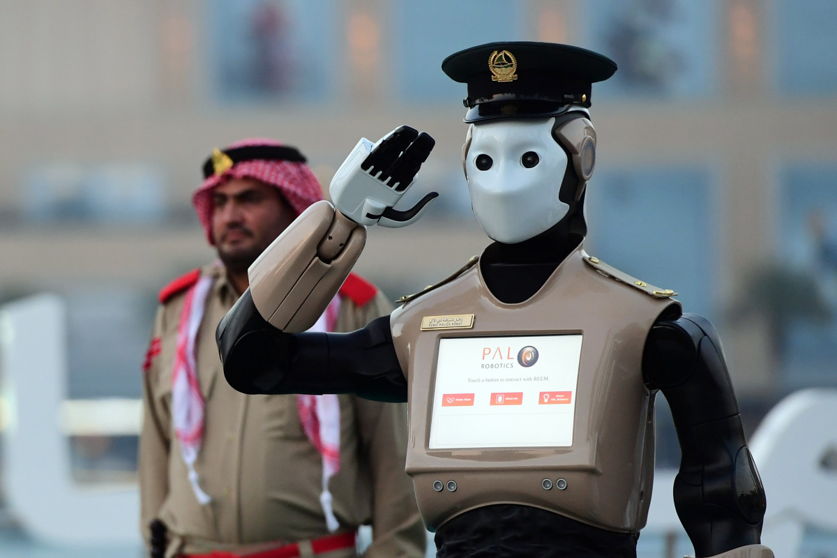 The world's first operational police robot stands at attention in Dubai before a military cannon is fired to mark the end of the fasting day on May 31st, 2017, for Muslims observing Ramadan.
