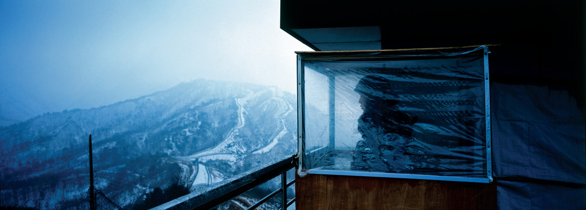 A South Korean soldier looks over the DMZ from a guard position on top of Observation Post 717, on the edge of the North Korean border.