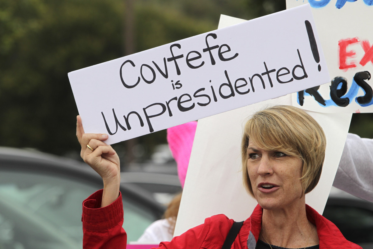 Demonstrator Annette Lievers carries a sign concerning a recent Donald Trump tweet as she joined about 200 demonstrators before a town hall meeting with Republican Representative Darrell Issa at a high school in San Juan Capistrano, California, on June 3rd, 2017.