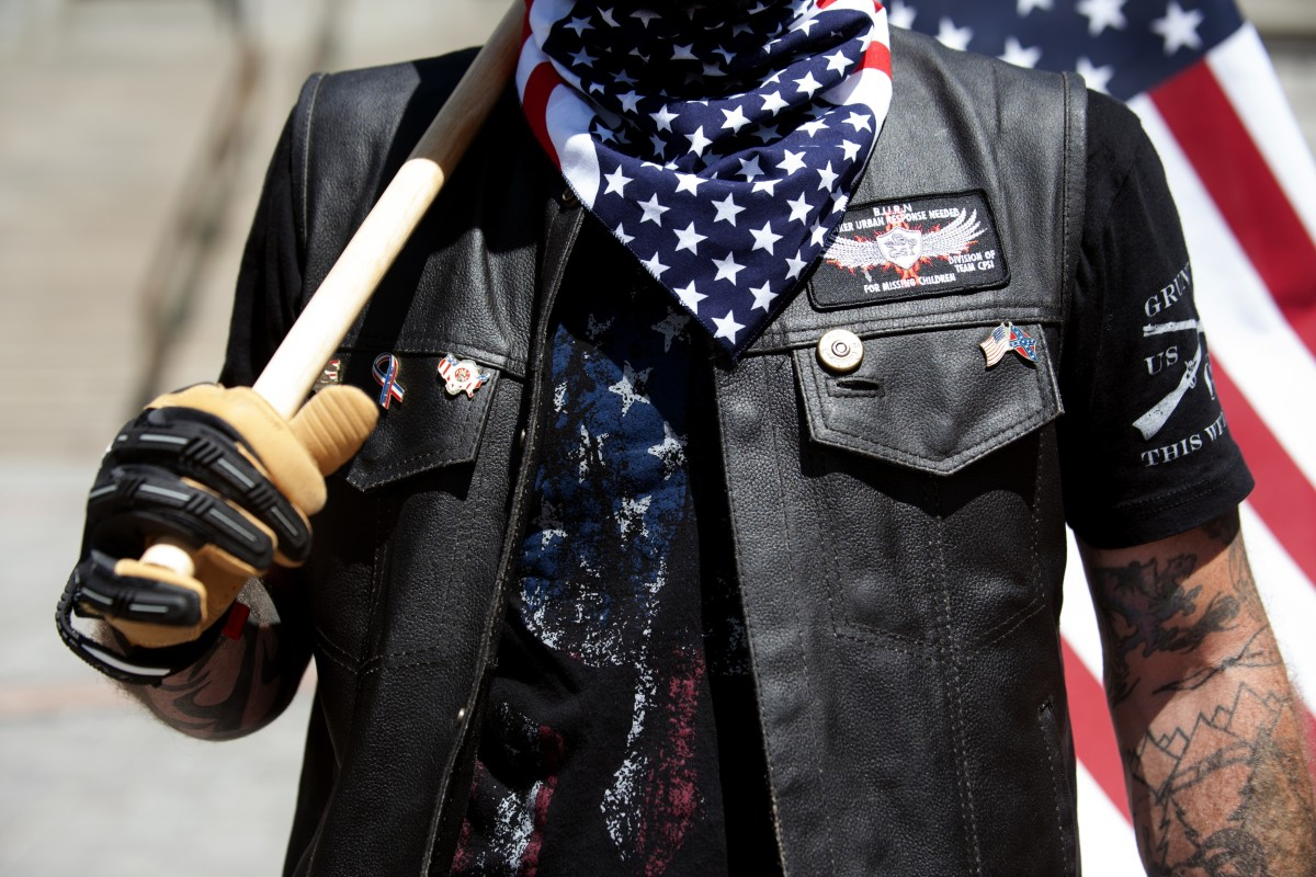 A right-wing demonstrator participates in the Denver March Against Sharia Law in Denver, Coloradom on June 10th, 2017. The march was supported by two right-wing groups, The Proud Boys, and Bikers Against Radical Islam.