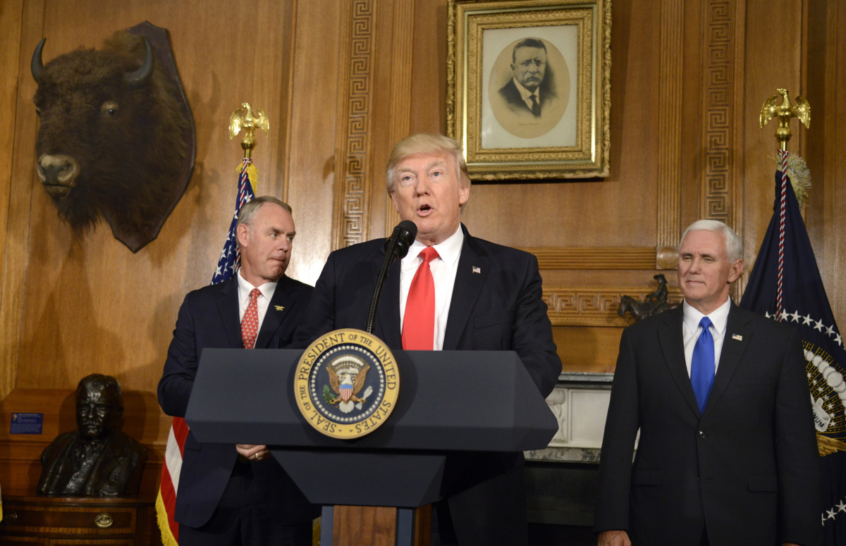 President Donald Trump makes remarks as Secretary of the Interior Ryan Zinke and Vice President Mike Pence listen prior to signing an Antiquities Executive Order on April 26th, 2017.