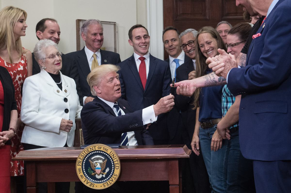 President Donald Trump hands over the pen he used to sign an executive order on the Apprenticeship and Workforce of Tomorrow initiatives on June 15th, 2017.