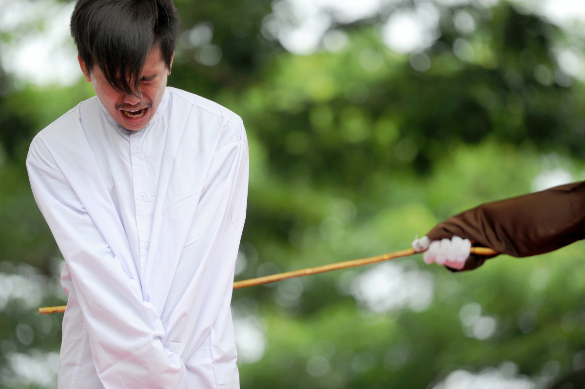 One of two Indonesian men is publicly caned for having sex, in a first for the Muslim-majority country where there are concerns over mounting hostility toward the small gay community, in Banda Aceh on May 23rd, 2017.