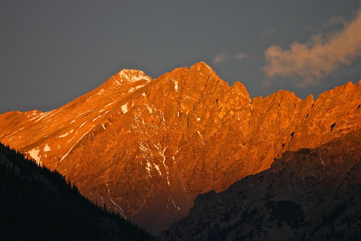 Sunrise alpenglow on the face of the Gore Range in Summit County, Colorado, where communities depend on winter snow to fuel their recreation economy, while nearby Denver waits for the snow to melt to fill reservoirs.