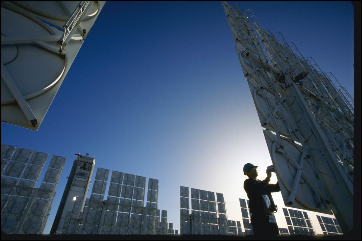 A technician servicing photovoltaic cells in a solar energy farm in Albuquerque, New Mexico.