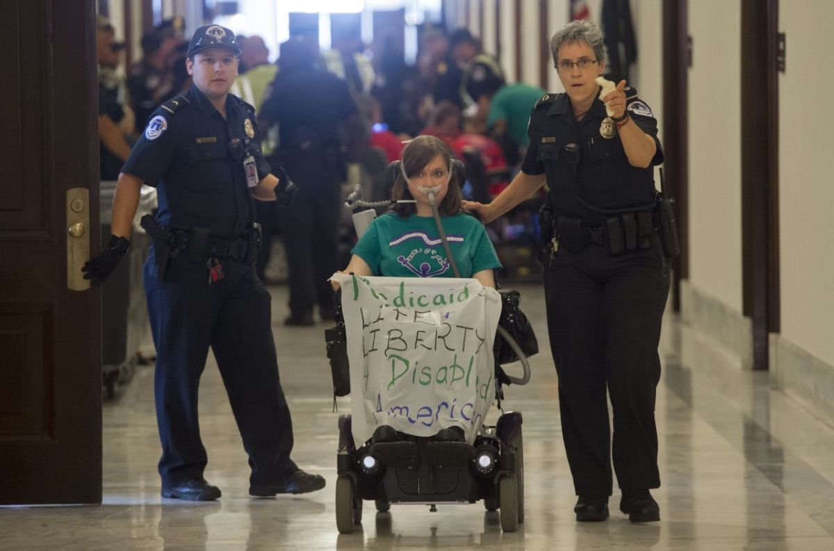 Police arrest a woman protesting against the Senate Republicans' draft health-care bill outside the Capitol Hill office of Senate Majority Leader Mitch McConnell on June 22nd, 2017.