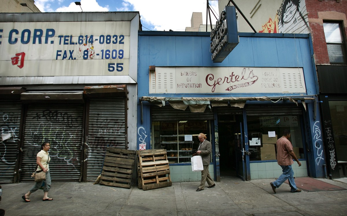 A customer walks out the front door on the last day of business for Gertel's Bake Shop, a kosher eatery, on June 22nd, 2007, in New York City.
