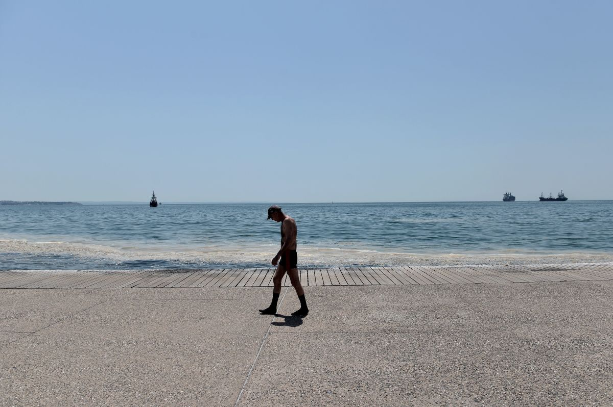 A man walks along the seaside promenade in Thessaloniki on June 29th, 2017, when temperatures there were expected to reach up to 43 degrees Celsius.