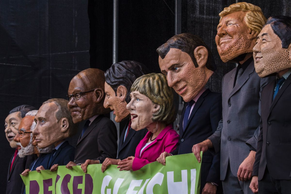 "Performers wearing masks of world leaders hold a placard reading: ""Better Off Equal! Close the Gap Between Rich and Poor"" during a demonstration called by several non-governmental organizations ahead of the G20 summit in Hamburg on July 2nd, 2017."