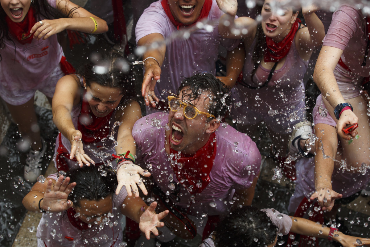 "Revellers enjoy the atmosphere during the opening day, or ""Chupinazo,"" of the San Fermin Running of the Bulls fiesta on July 6th, 2017, in Pamplona, Spain. The annual Fiesta de San Fermin involves the daily running of the bulls through the historic heart of Pamplona to the bull ring."