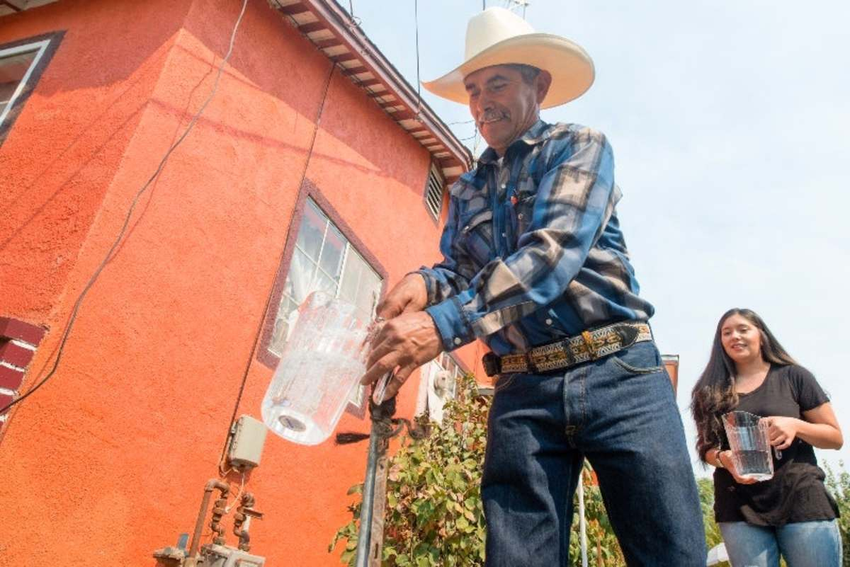 Homeowner Leonicio Ramirez and daughter Tania Ramirez are the first residents to receive water through a water distribution system in East Porterville, California, on August 19th, 2016. Engineers at the California Department of Water Resources designed a system to deliver water from the city of Porterville to 1,800 homes in its neighboring community to the east.