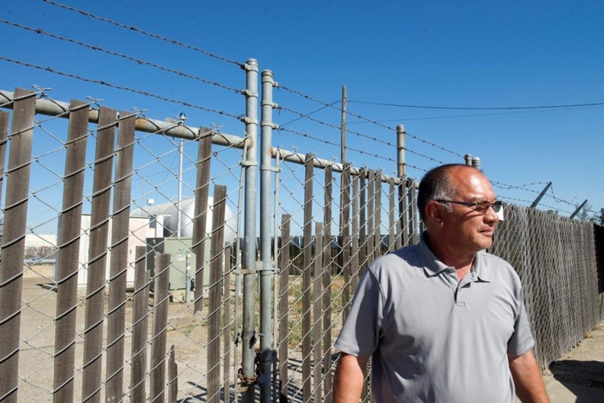 Carlos Arias, district manager for the small community of Del Rey, California, in the San Joaquin Valley, stands near one of the community's water wells. Del Rey has 1,2,3-Trichloropropane in its water, a contaminant recognized by the state to cause cancer, but not yet regulated.