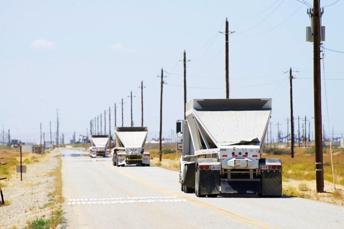 Trucks enter an oilfield in Kern County. San Joaquin Valley residents face a range of health issues, including air pollution from vehicles and industry in the region.