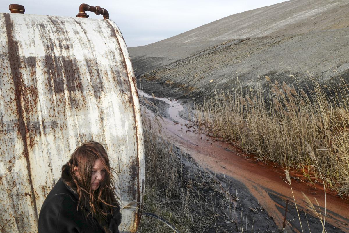Georgia de la Garza, a local environmental activist in southern Illinois looks at Mercury run off by an active mine.