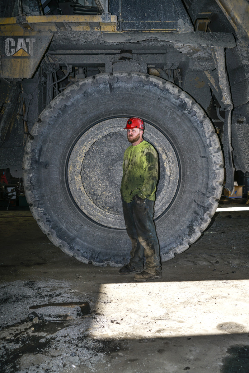 Ryan Langley, an employee of Eagle River Coal, in front of one of the company's hauling trucks.
