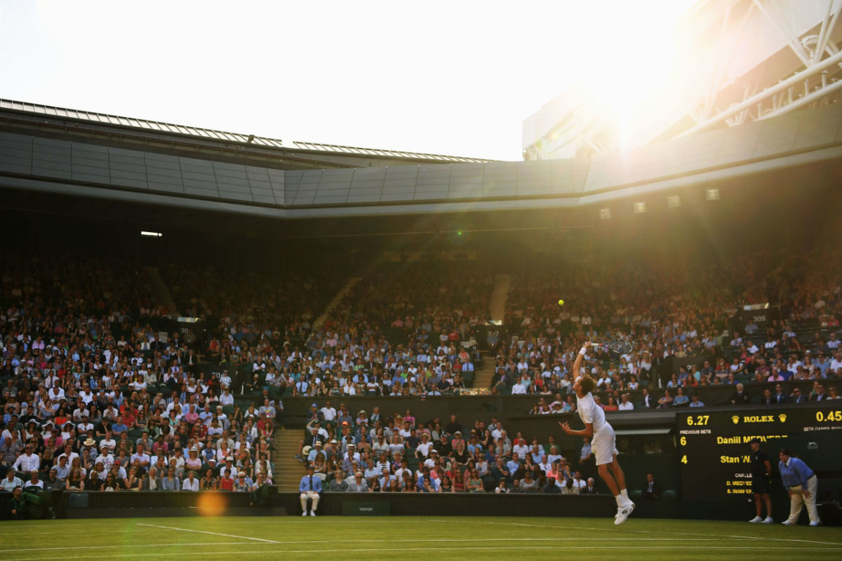 Danil Medvedev of Russia serves during the Gentlemen's Singles first round match against Stan Wawrinka of Switzerland on day one of the Wimbledon Lawn Tennis Championships at the All England Lawn Tennis and Croquet Club on July 3rd, 2017, in London, England.