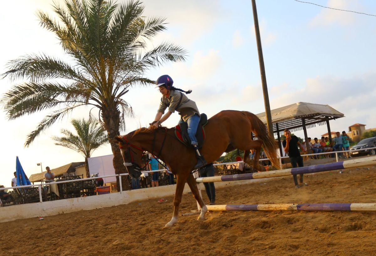 Seventeen-year-old Heba Seifalden Shahein, who was born with congenital amputation in one leg, trains at a riding school in Gaza City on July 5th, 2017. Heba, who lives between Norway and Gaza, started riding at the beginning of the year and she will compete in a local competition in July.