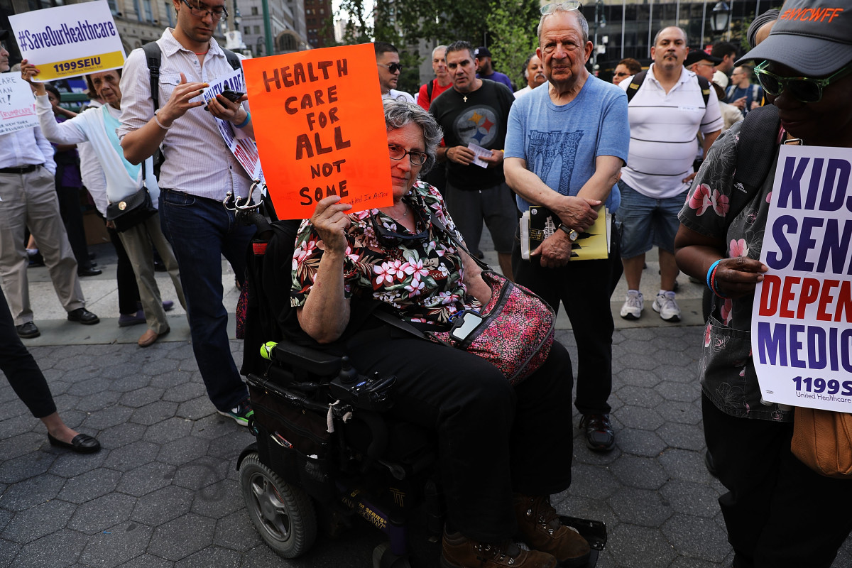Jean Ryan from Disabled in Action joins others in protesting against the Senate health-care bill in New York City on June 28th, 2017.