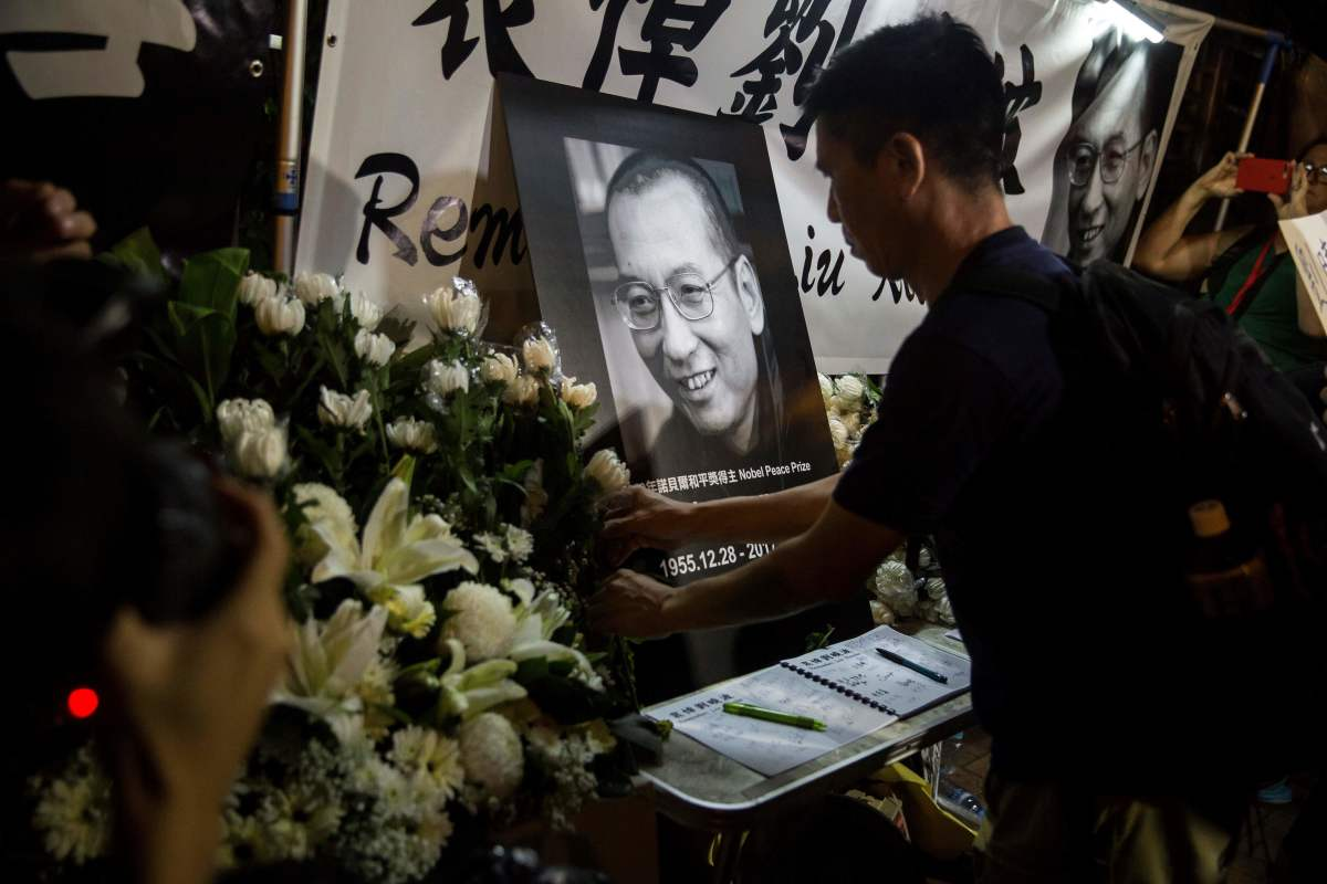 Protesters pay their respects outside the Chinese Liason Office of Hong Kong after the death of Chinese Noble laureate Liu Xiaobo, in Hong Kong on July 13th, 2017. The United States called on China to free the dissident's widow from house arrest and let her leave the country.