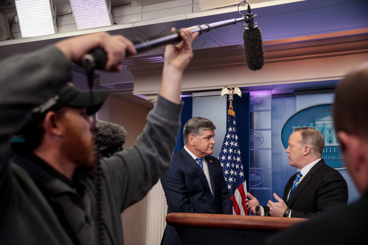 Fox News television personality and political commentator Sean Hannity speaks with Sean Spicer in the James Brady Press Briefing Room at the White House on January 24th, 2017.