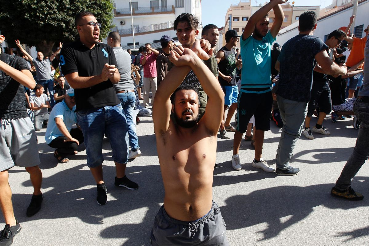 Demonstrators gesture and shout slogans in front of Moroccan security forces during a march in defiance of a government ban in the northern Moroccan city of Hoceima on July 20th, 2017.