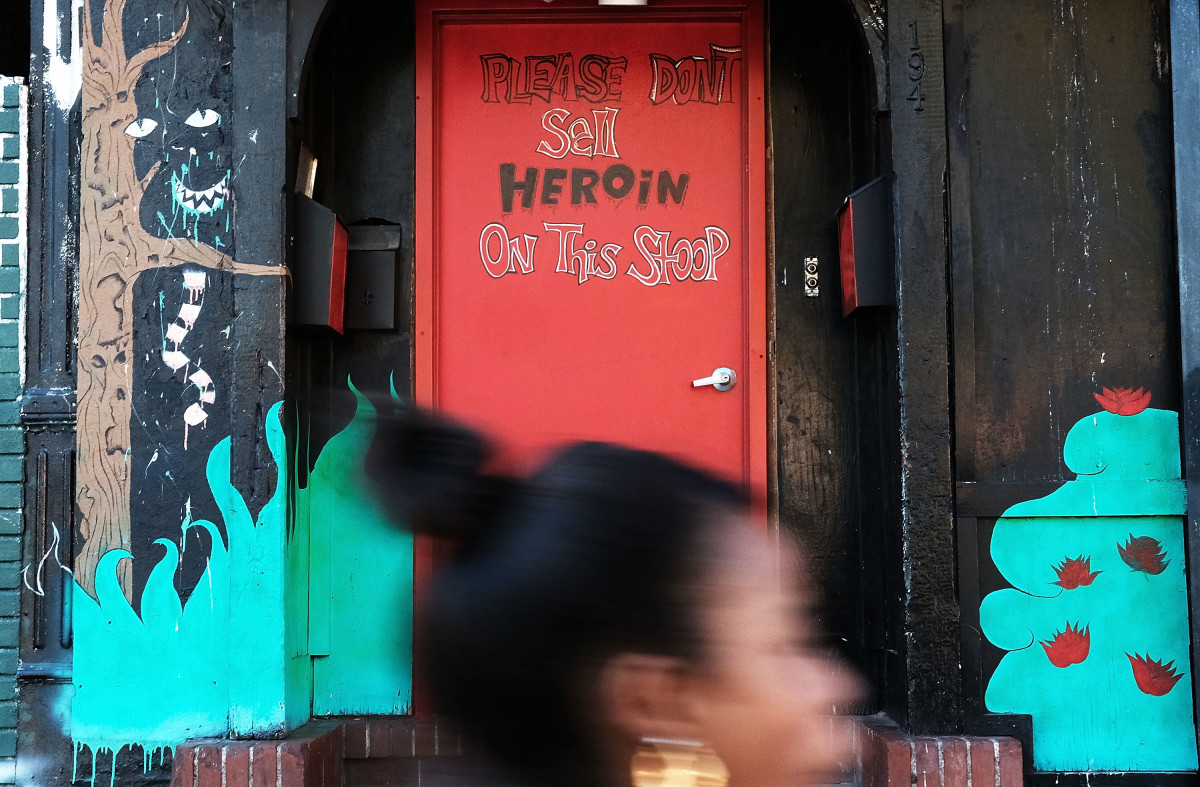 A door is painted with the message to stop selling heroin on a street in a neighborhood in New York City.