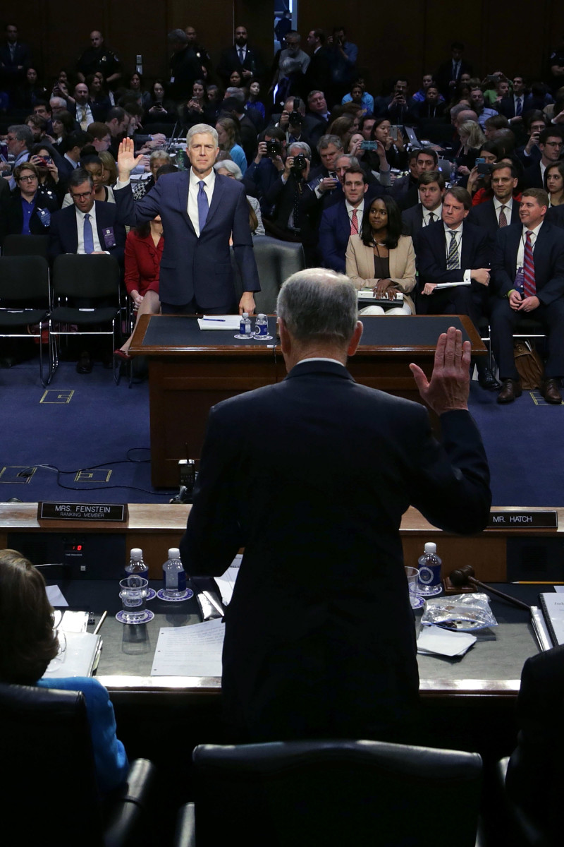 Senate Judiciary Committee Chairman Charles Grassley (R-Iowa) swears in Judge Neil Gorsuch during the first day of his Supreme Court confirmation hearing.