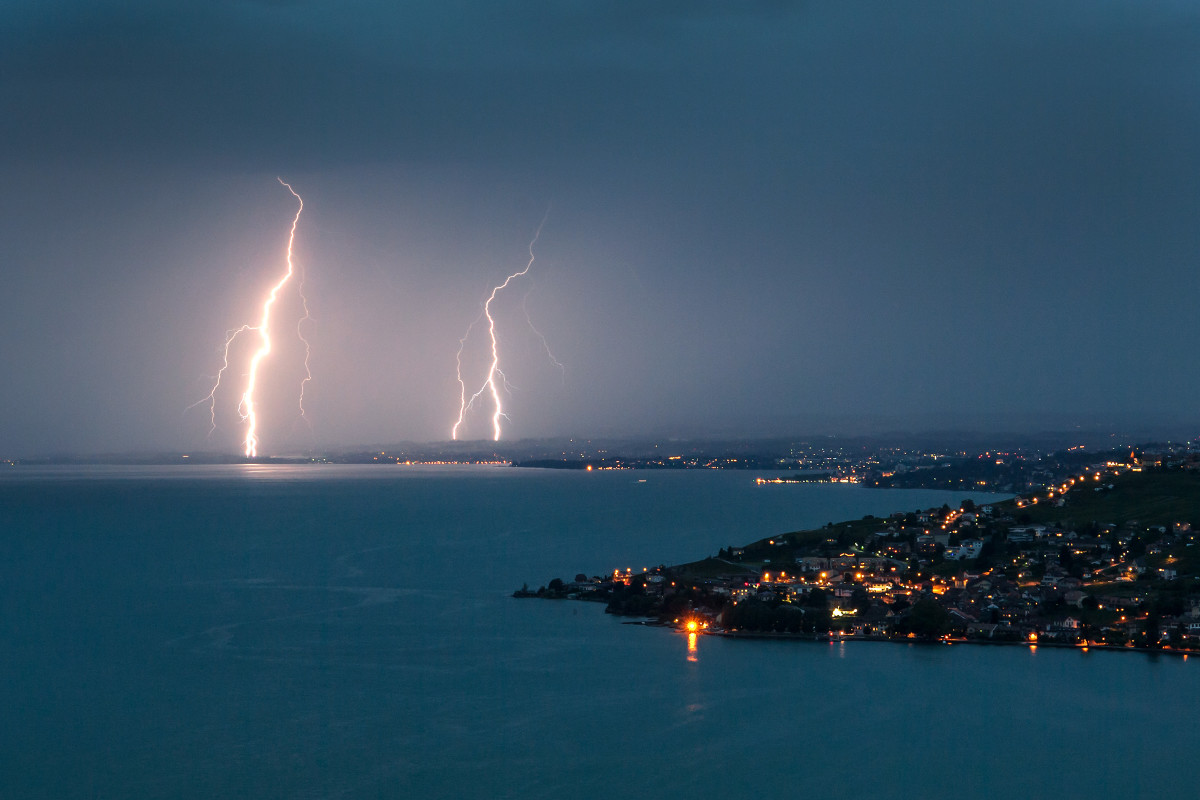 Lightning illuminates the night sky over the village of Cully surrounded by the vineyard terraces of Lavaux on the bank of Leman Lake from Chexbres on late July 30th, 2017.