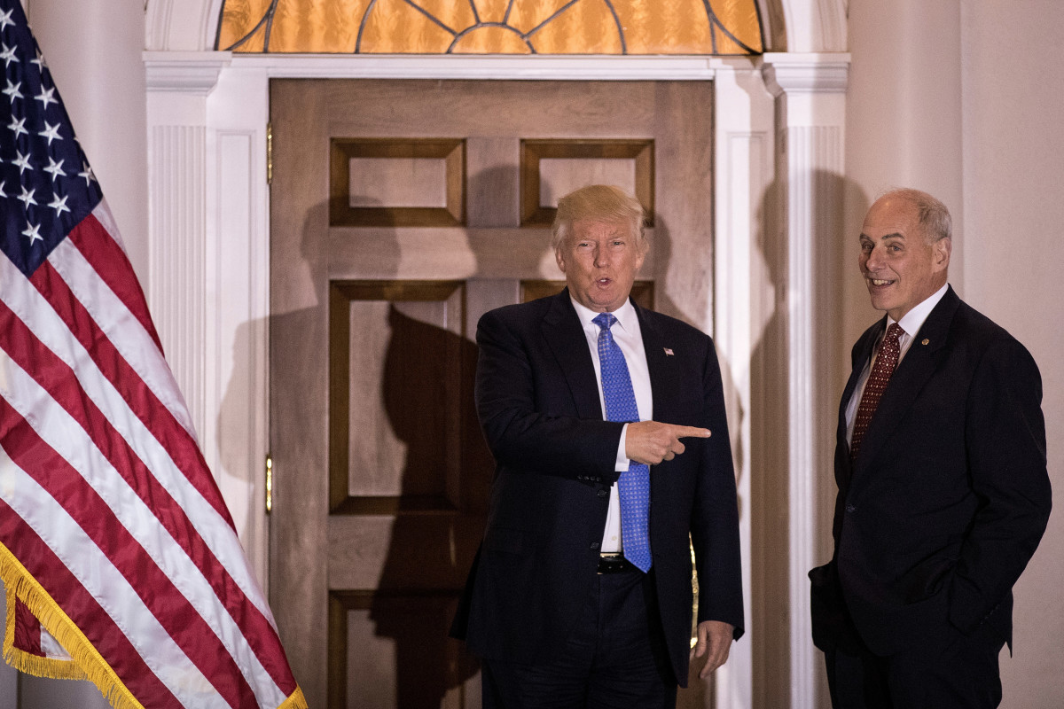 Donald Trump points at U.S. Marine Corps General John Kelly before their meeting at Trump International Golf Club on November 20th, 2016.