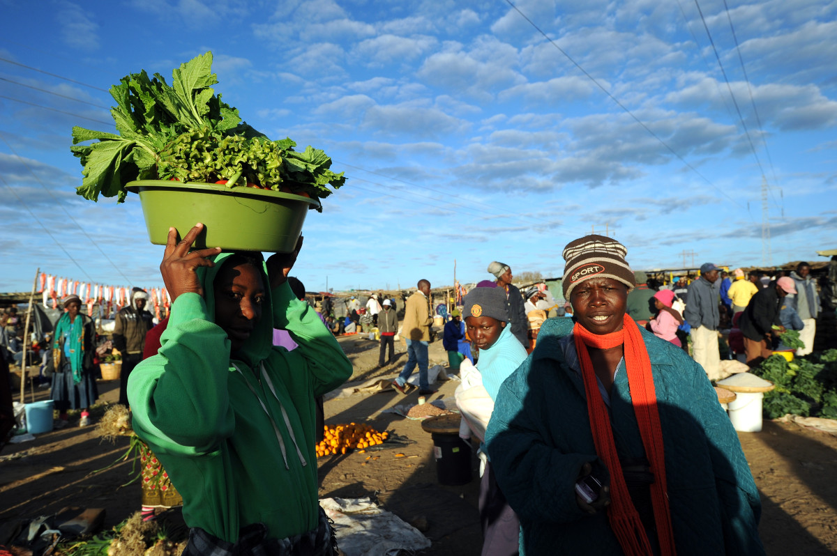 Zimbabwean women shop for vegetables in Jambanja market in Seke, south of Harare.