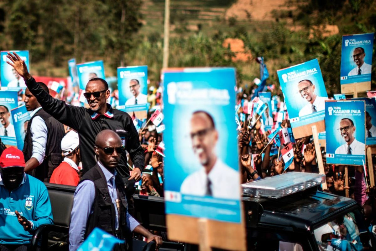 Incumbent Rwandan President Paul Kagame (L) greets a crowd of supporters as he arrives for a campaign rally on July 31st, 2017, in Gakenke ahead of the August 4th presidential election. Kagame and his Rwanda Patriotic Front Party have held an iron grip on power since overthrowing the extremist Hutu regime, which perpetrated the 1994 genocide of 800,000 Tutsis.