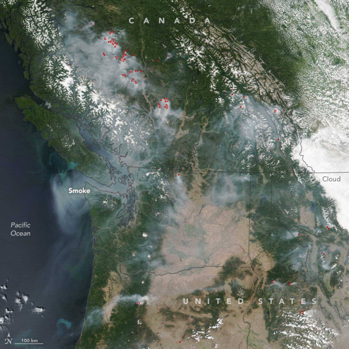 Wildfires, indicated here by red marks, dot the Pacific Northwest.