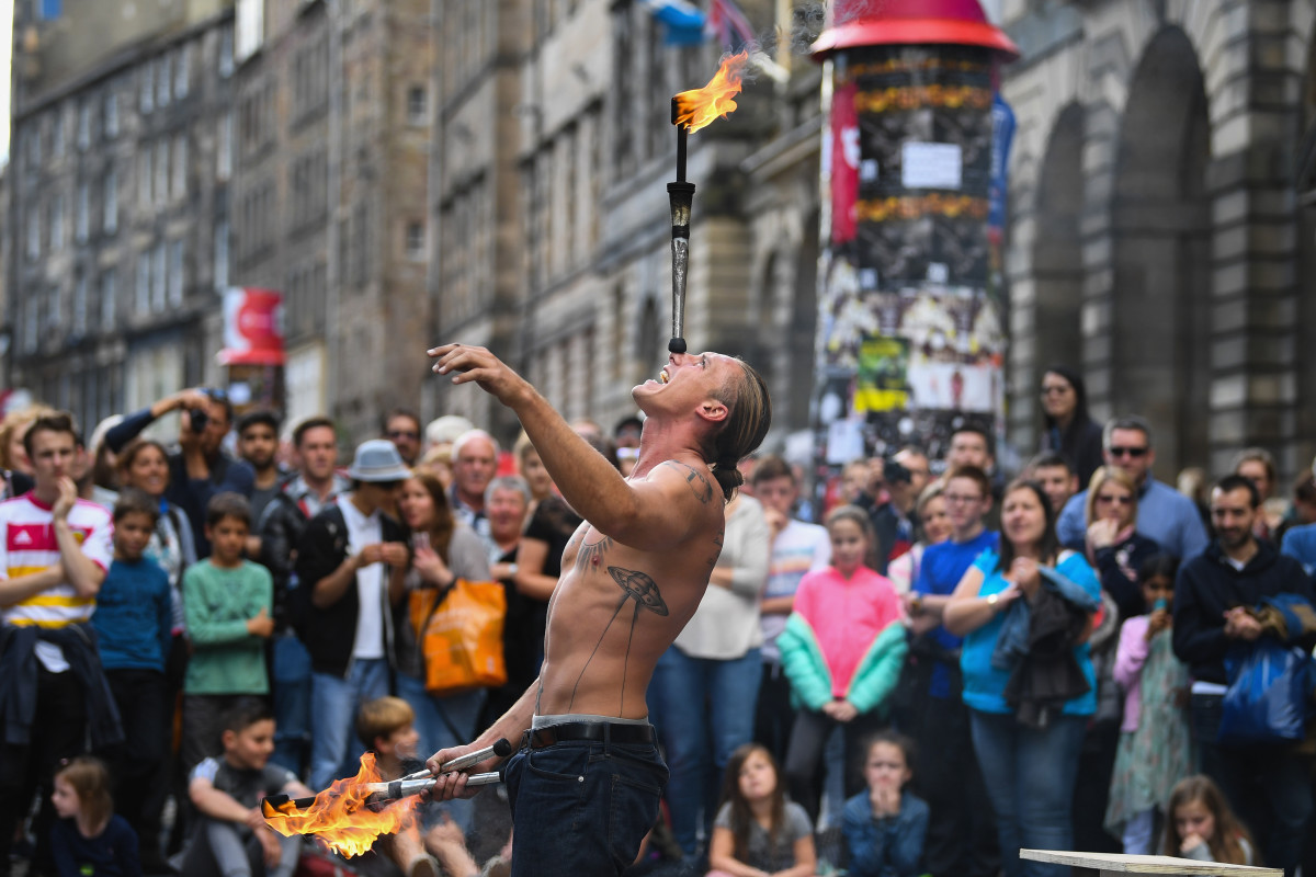 Edinburgh Festival Fringe entertainers perform on the Royal Mile on August 7th, 2017, in Edinburgh, Scotland. This year marks the 70th anniversary of the largest performing arts festival in the world, with an excess of 30,000 performances of more than 2,000 shows.
