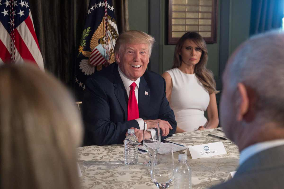 President Donald Trump smiles before a meeting with administration officials and First Lady Melania Trump on the opioid addiction crisis at the Trump National Golf Club in Bedminster, New Jersey, on August 8th, 2017.