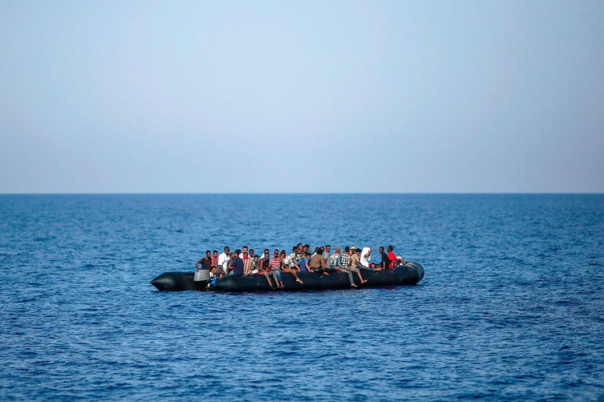 Migrants wait to be rescued by Italian coast guard in the Mediterranean Sea, 30 nautical miles from the Libyan coast, on August 6th, 2017.