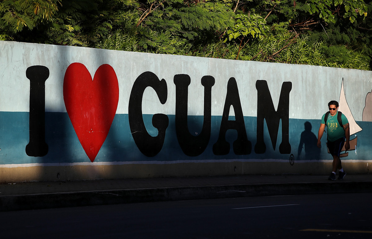 A pedestrian walks by a mural on August 14th, 2017, in Tamuning, Guam.