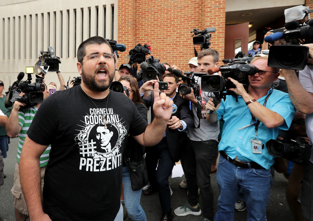 Matthew Heinbach (L) of the white nationalist Traditionalist Workers Party shouts at journalists gathered outside the Charlottesville General District Court building on August 14th, 2017, in Charlottesville, Virginia.