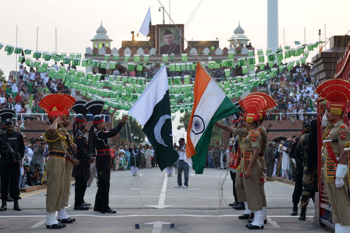 Pakistani Rangers (black) and Indian Border Security Force personnel (brown) perform during the daily beating of the retreat ceremony at the India-Pakistan Wagah Border Post, some 35kms west of Amritsar on August 14th, 2017. Pakistan celebrates its independence on August 14th, one day before India's independence day on August 15th.