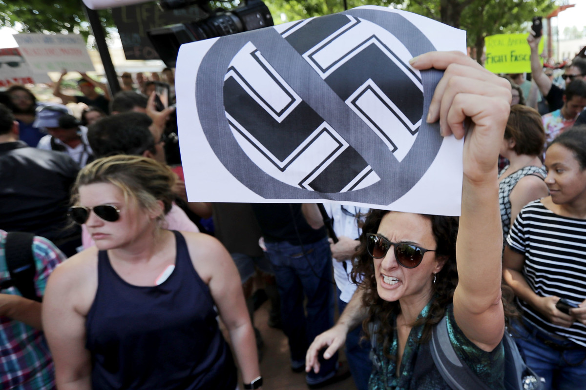 Protesters shout anti-Nazi chants after chasing alt-right blogger Jason Kessler from a news conference on August 13th, 2017, in Charlottesville, Virginia.