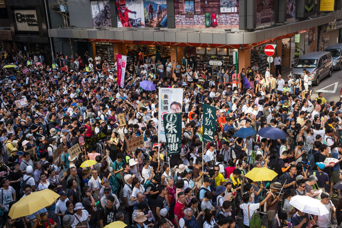 Protesters attend a rally to support jailed activists Joshua Wong, Nathan Law, and Alex Chow on August 20th, 2017, in Hong Kong, China.
